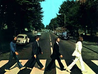 The Beatles, crossing Abbey Road.