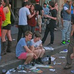 Kids, cell phones and lots of litter up and down 6th Street.