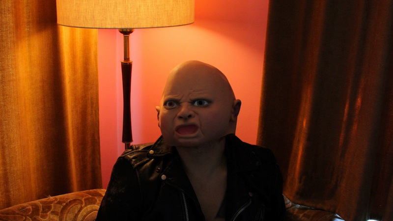 Ty Segall with a creepy baby mask