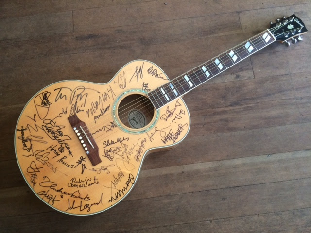 Planned Parenthood raffle guitar